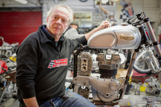 Laurent Romuald the boss of Machines et Moteurs near a Triumph Special with a supercharger in construction.